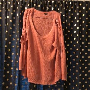 Pink oversized sweater tie closures on sleeves